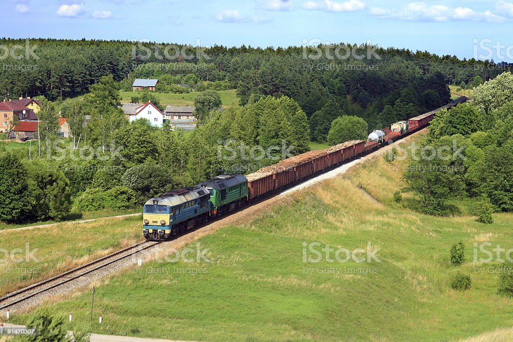Summer landscape with freight train stock photo