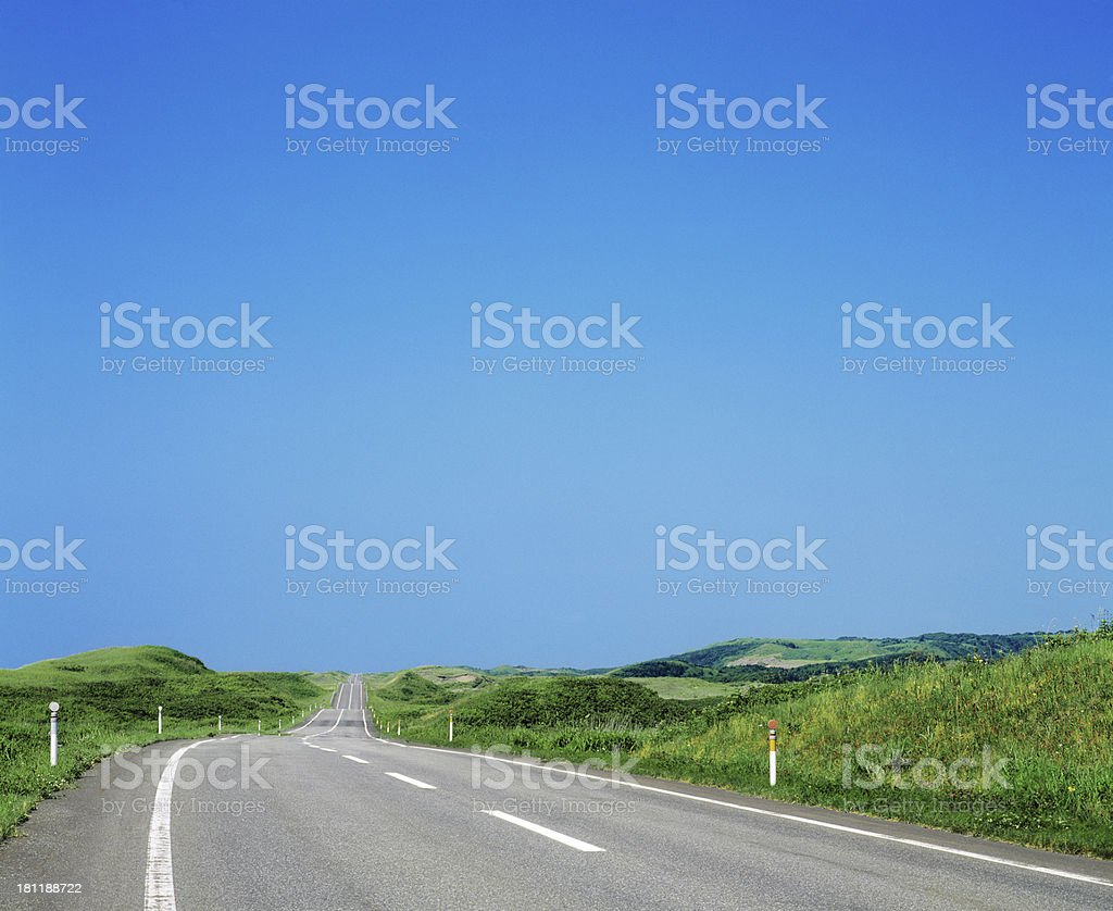 Summer landscape with rural road and cloudy sky royalty-free stock photo