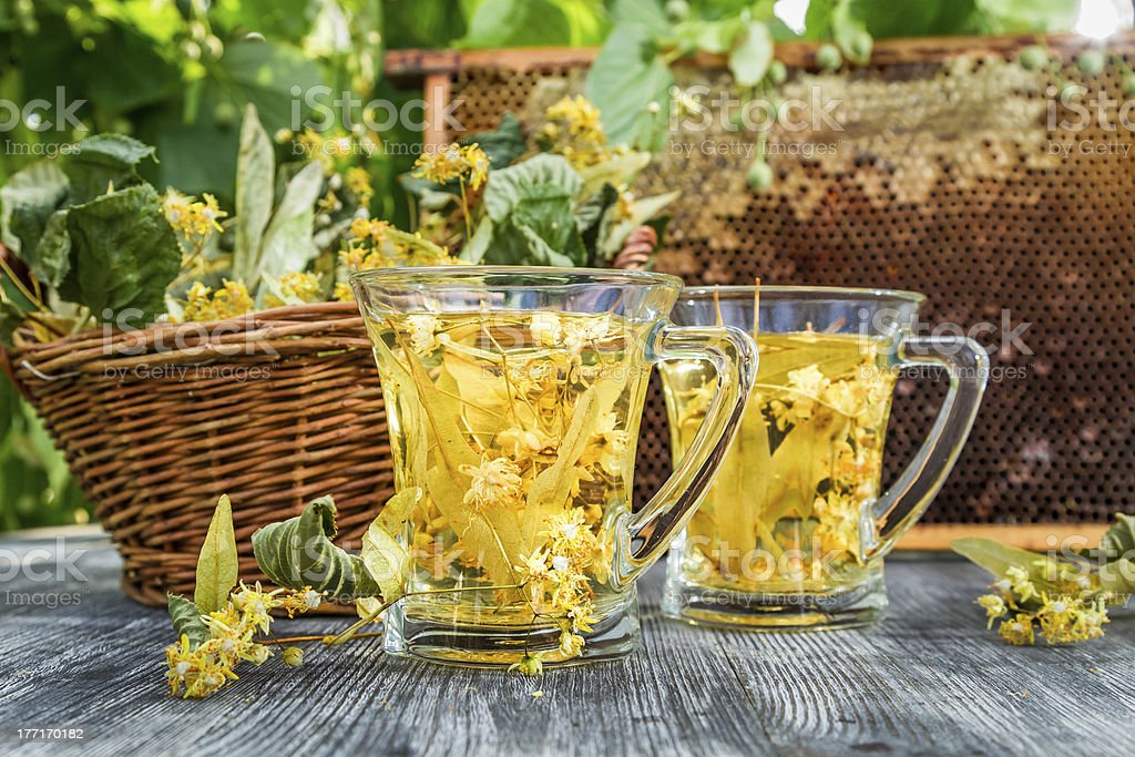 Summer lime tea with honey served in the garden royalty-free stock photo