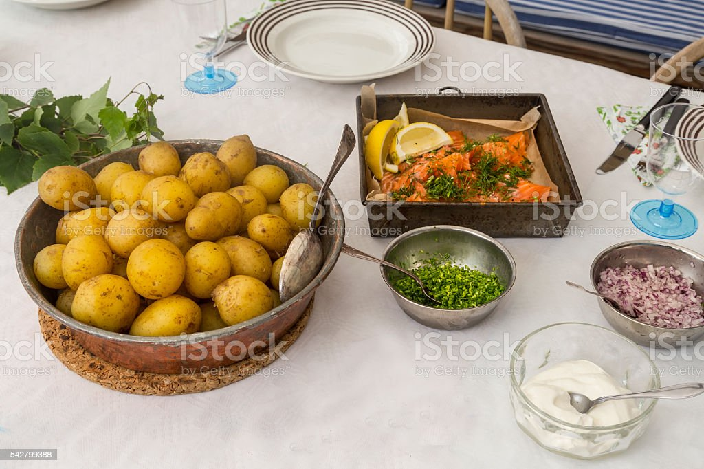 Summer lunch smoked salmon and new potatoes. stock photo