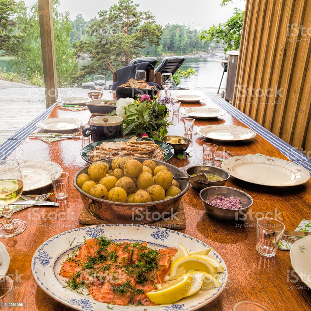 Summer lunch with a view, smoked salmon and new potatoes. stock photo