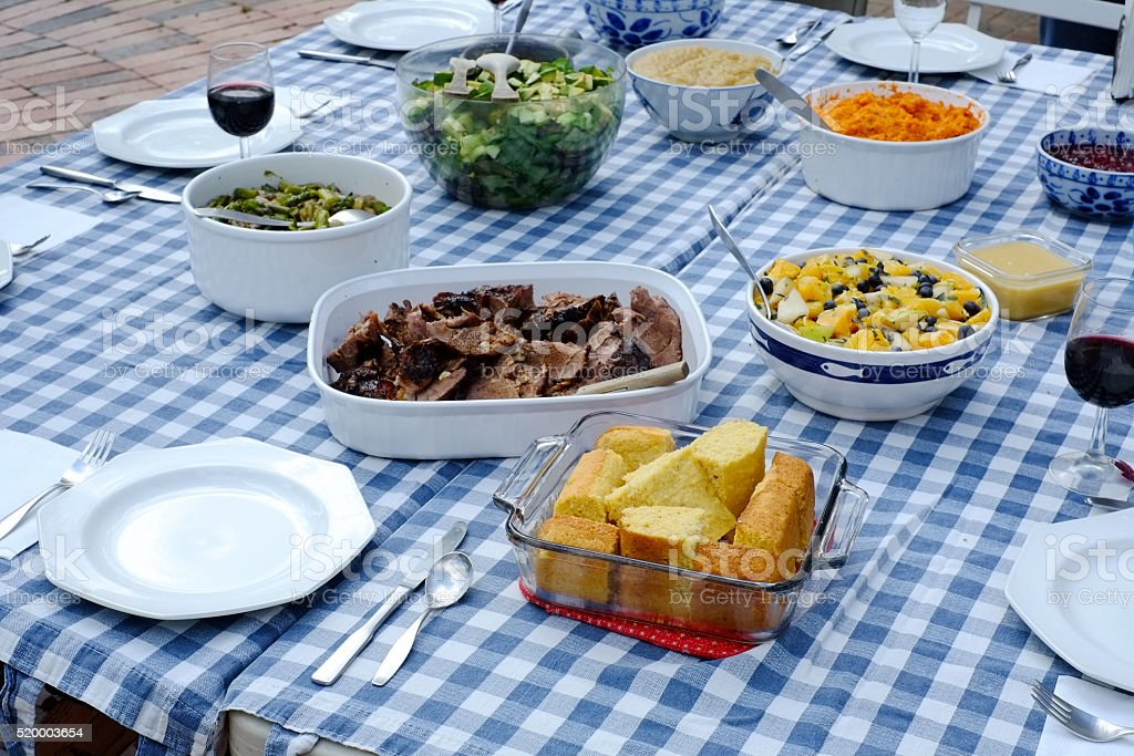 Summer Meal on Blue and White  Table Cloth Background Outdoors stock photo