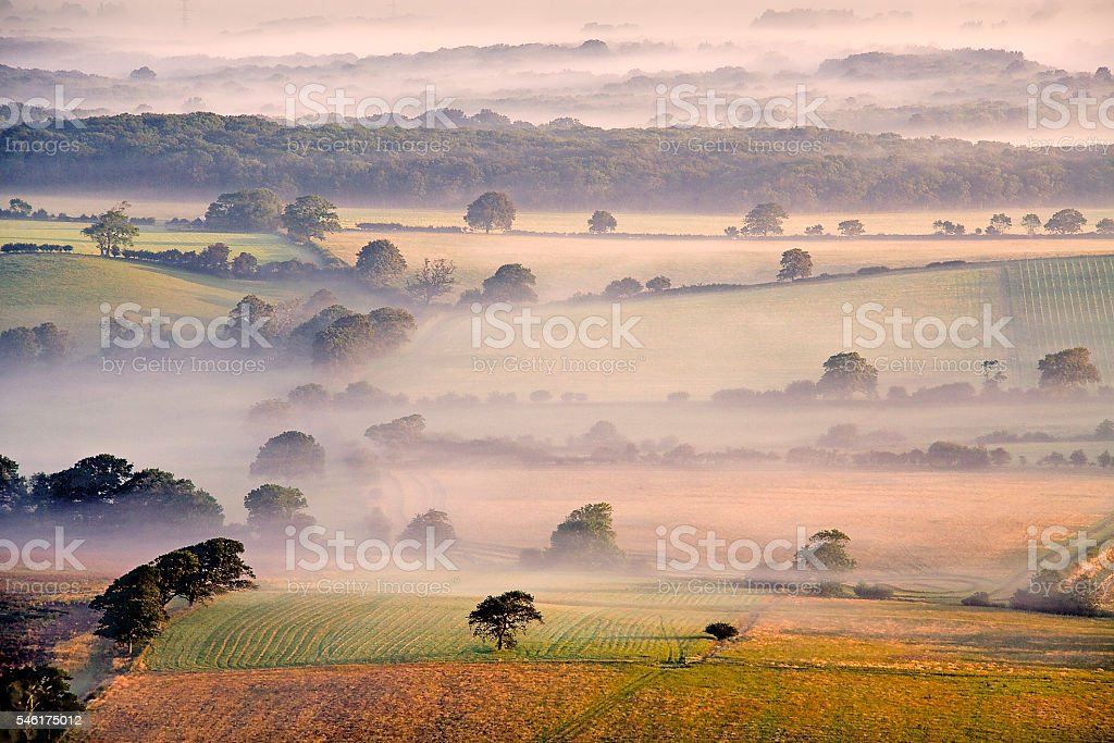 Summer mist rising from the Weald stock photo