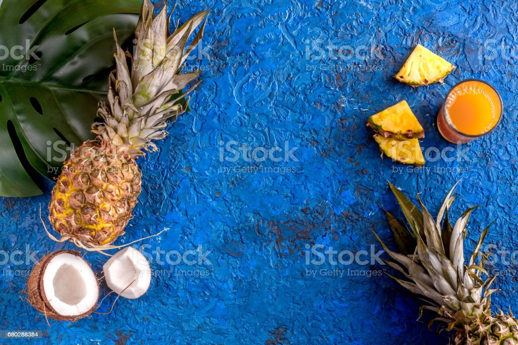summer mockup with pineapple and coconut on blue table background top...