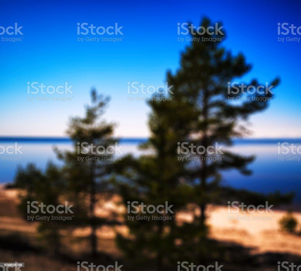 Summer morning on smooth mountain lake landscape bokeh stock photo