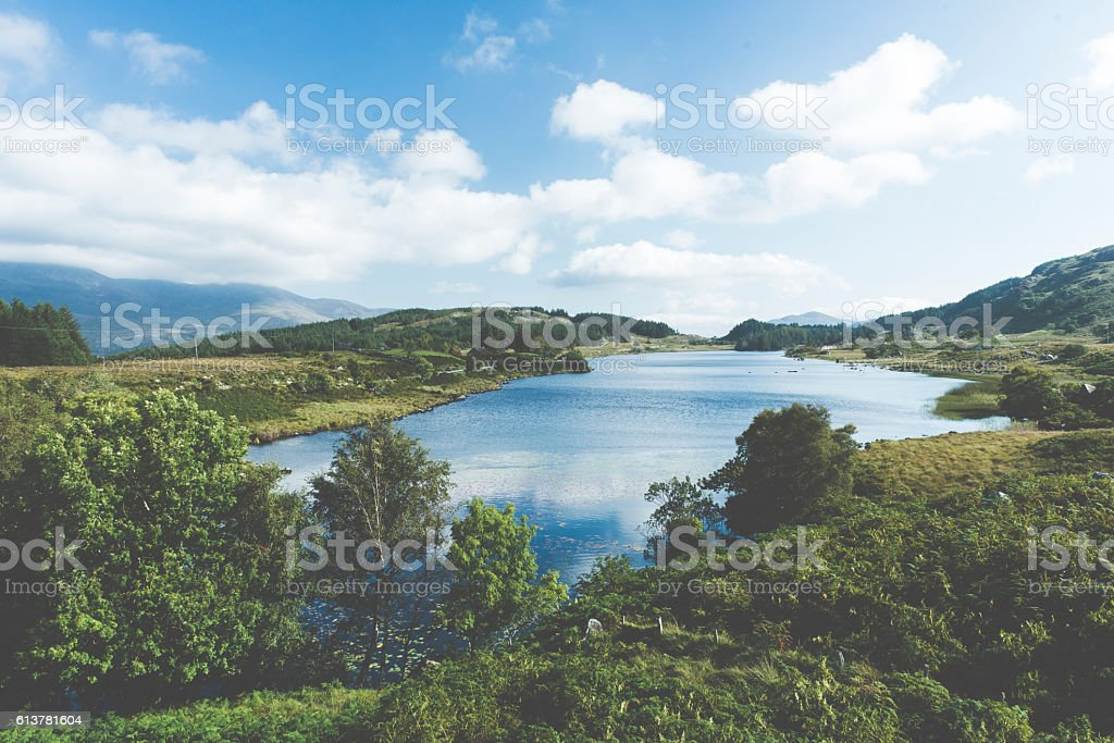 Summer mountain hills and lake landscape stock photo