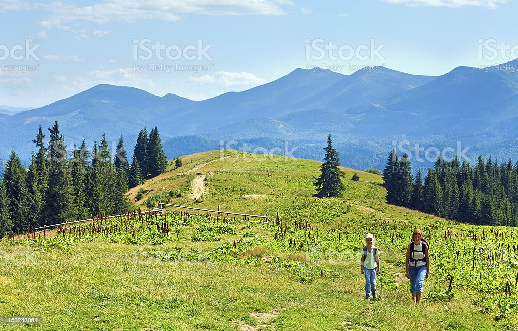 Summer mountain plateau landscape and family royalty-free stock photo