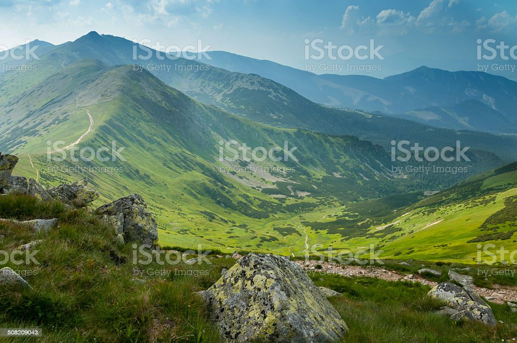 Summer mountains green grass and blue sky landscape. stock photo