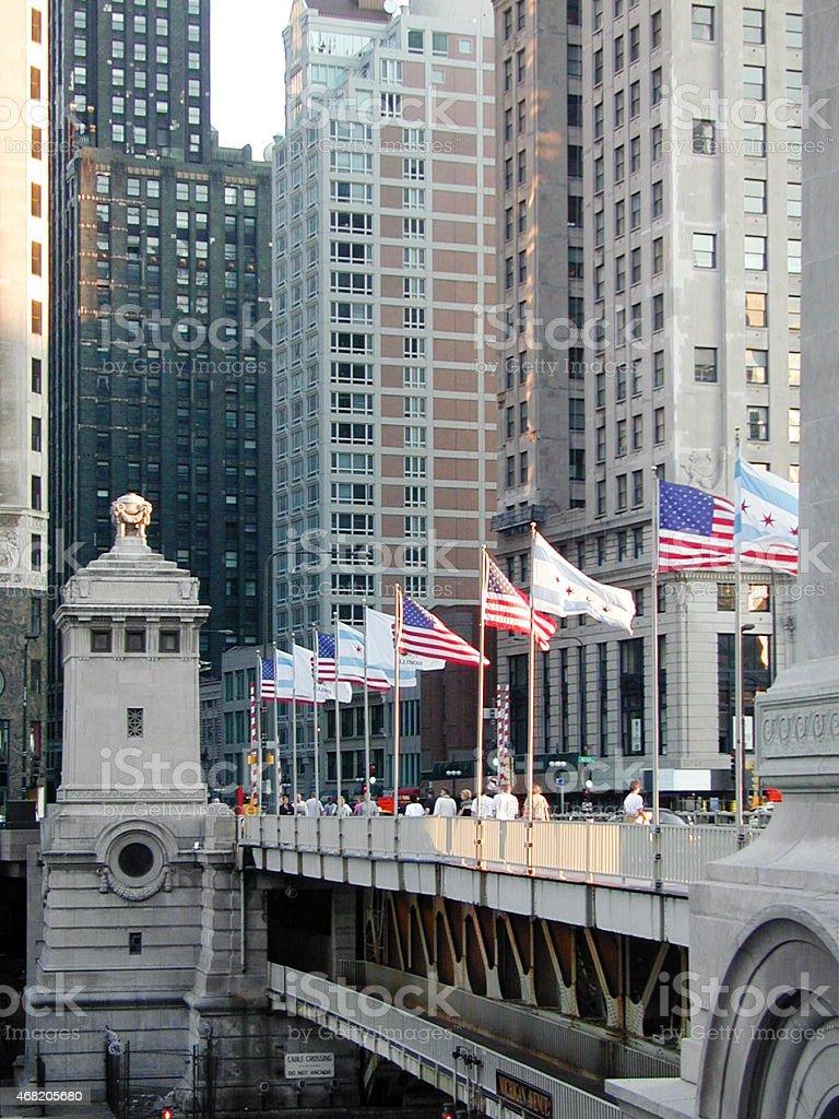 Summer on Michigan Avenue Bridge, Chicago. Skyscrapers. Flags. stock photo