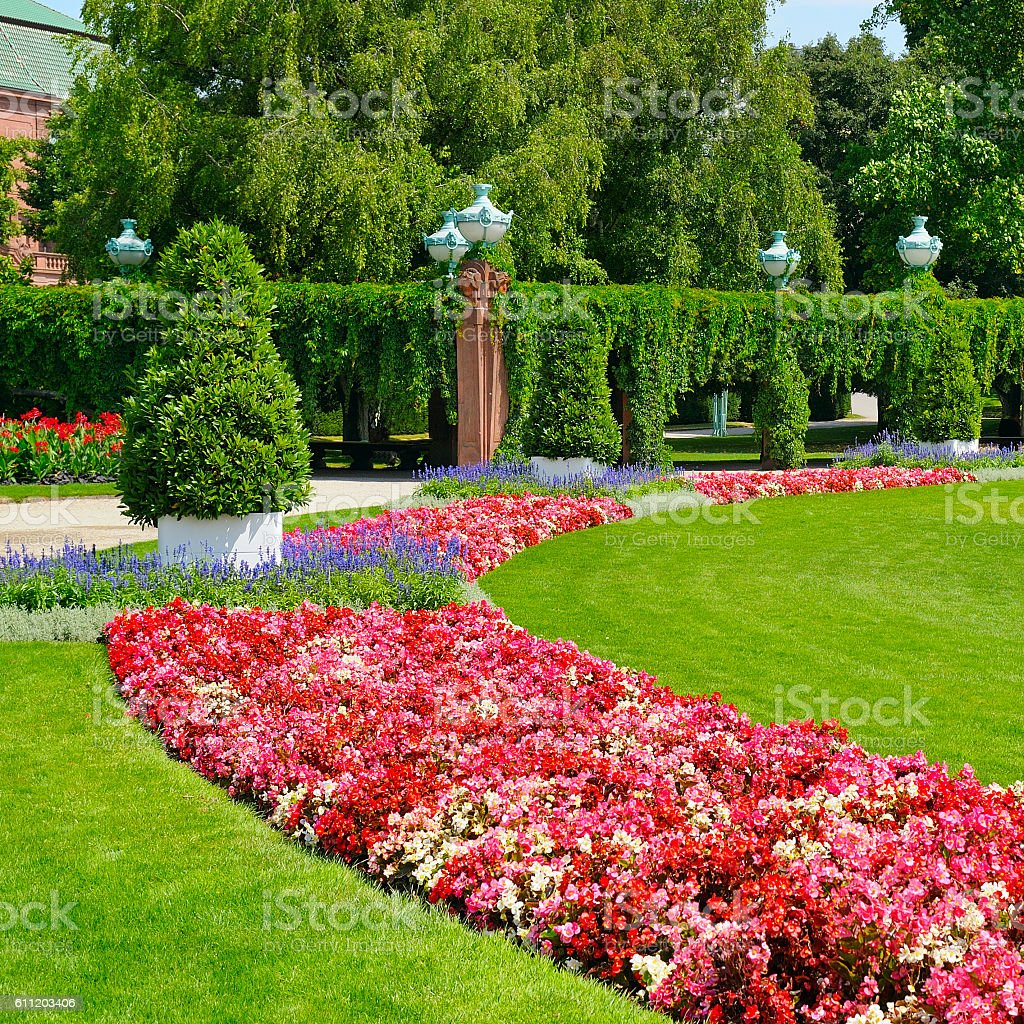 summer park with flowerbed and green lawn stock photo