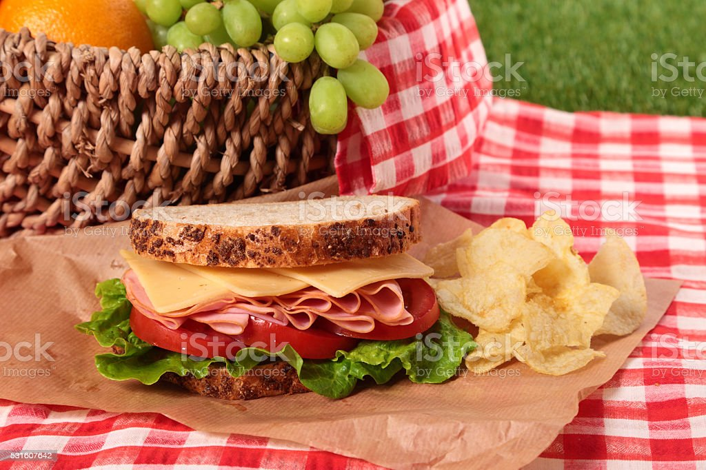 Summer picnic basket ham and cheese sandwich stock photo