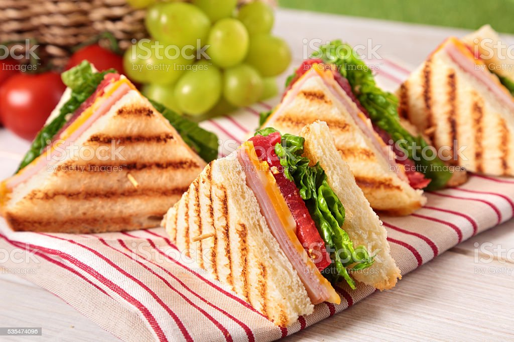 Summer picnic club sandwich ham and cheese in a row stock photo