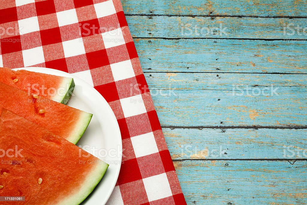 Summer picnic concept with watermelon and checkered napkin stock photo