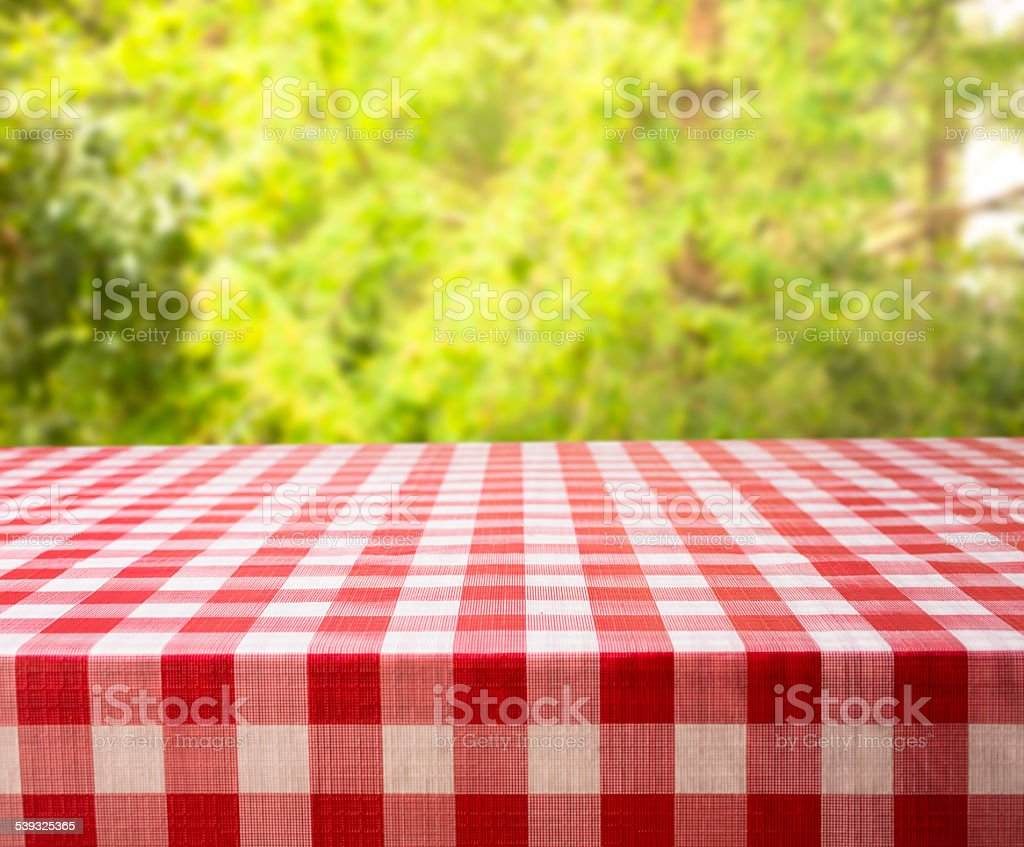 Summer picnic in forest or park area. Trees, table. stock photo