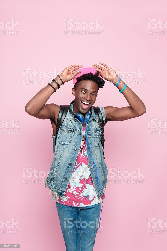 Summer portrait of excited afro american guy stock photo