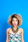 Summer portrait of surprised afro american young woman