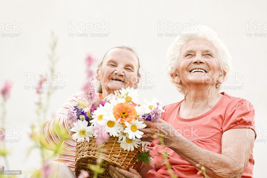 Summer portrait of two happy elderly women royalty-free stock photo
