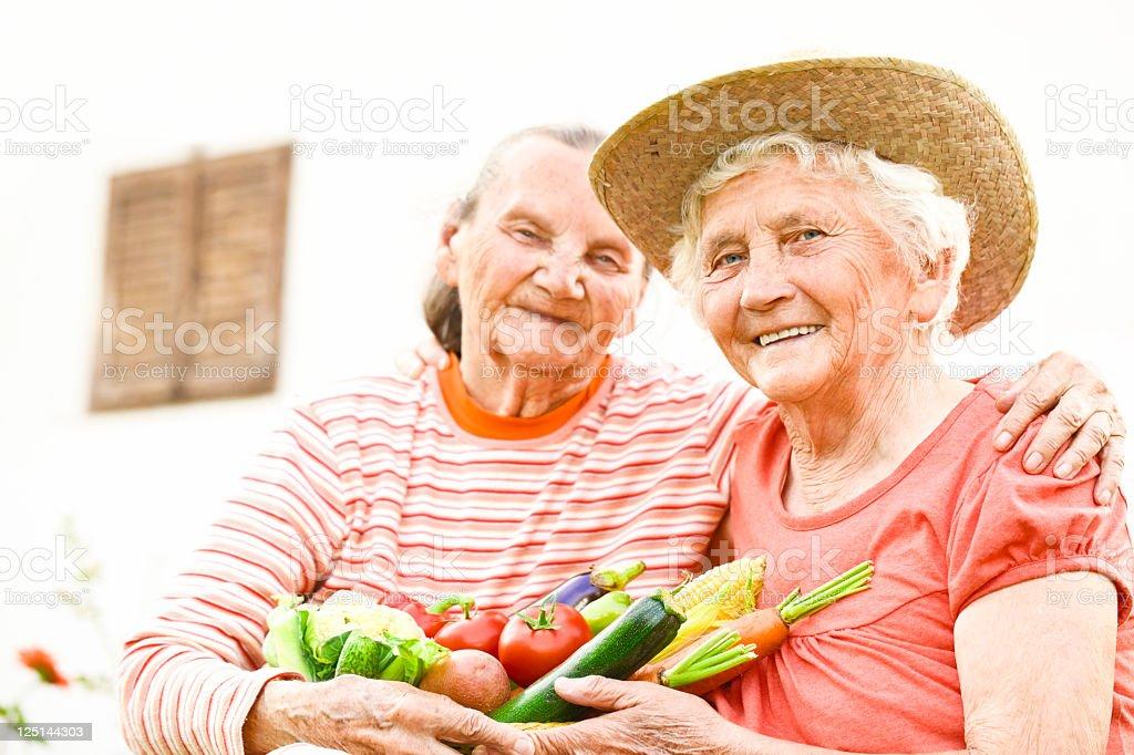 Summer portrait of two lovely elderly women royalty-free stock photo