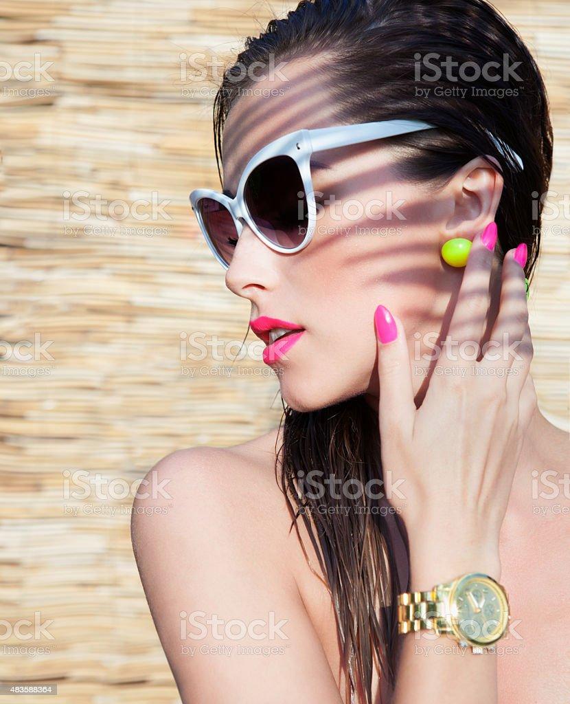 Summer portrait of young attractive elegant brunette woman stock photo