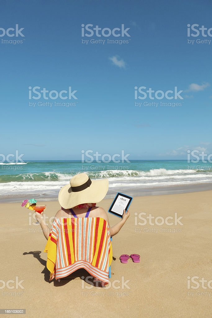 Summer Reading with eBook Tablet Computer on Tropical Beach royalty-free stock photo