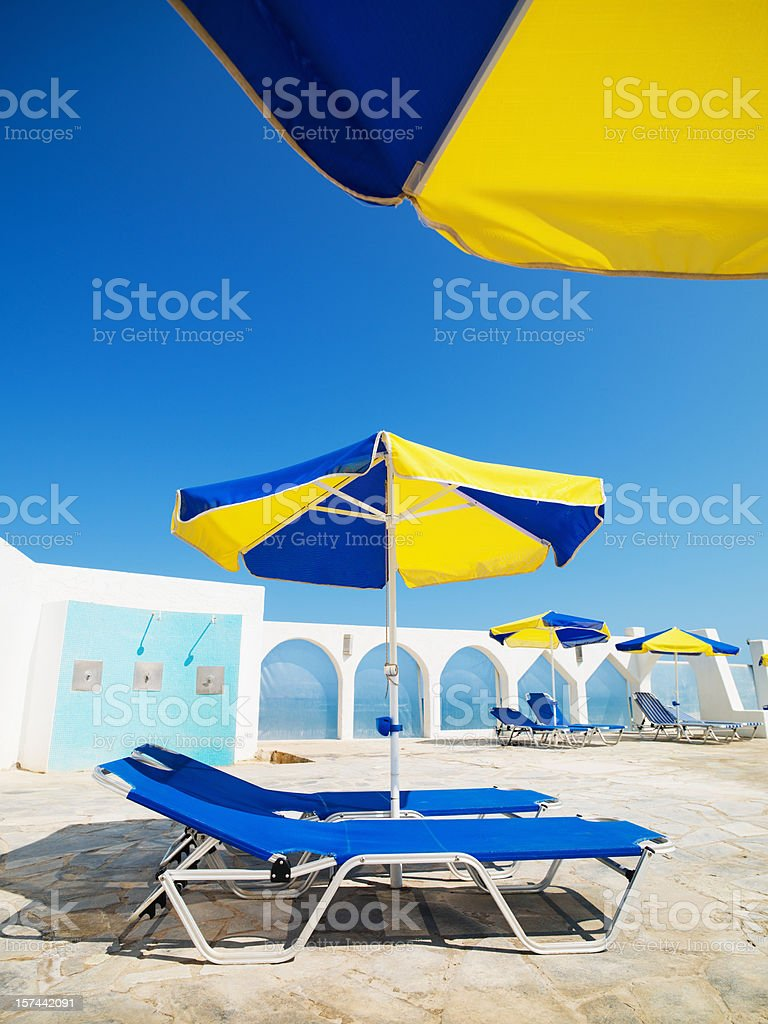 Summer Relaxation Sunchairs and Beach Umbrella royalty-free stock photo