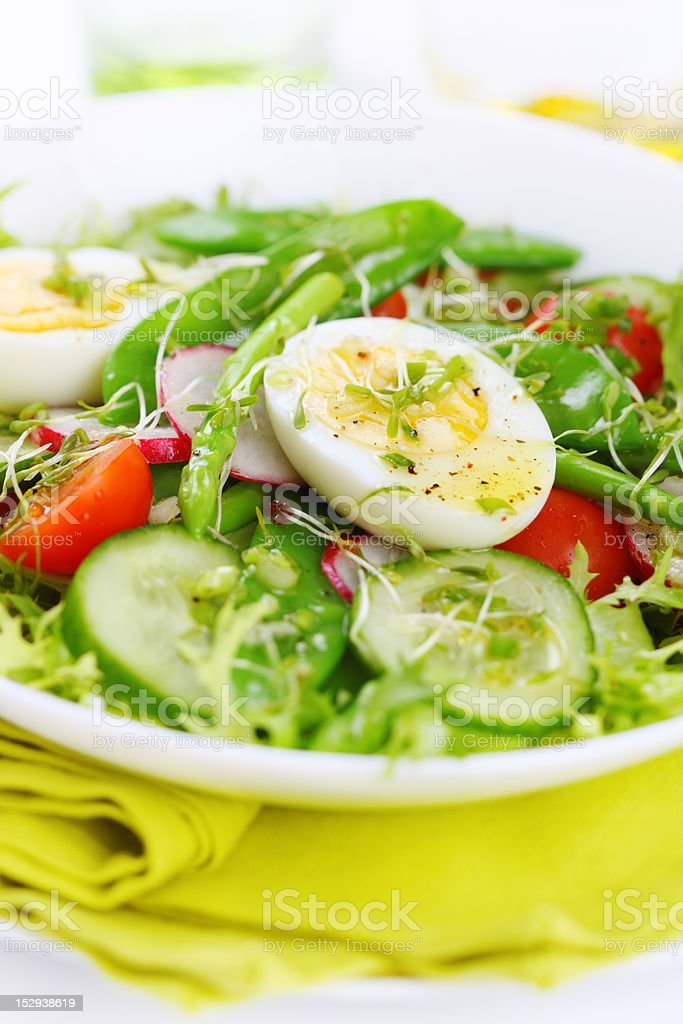 Summer salad of tomatoes, cucumbers, asparagus and young green peas stock photo