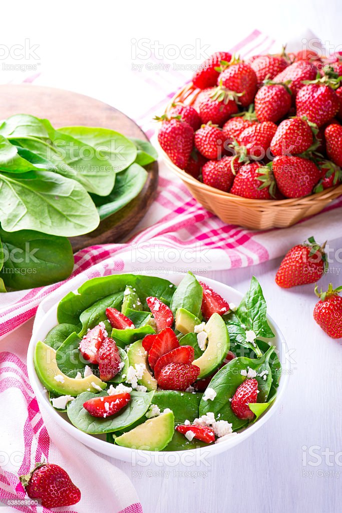 Summer salad with strawberry, avocado and spinach stock photo