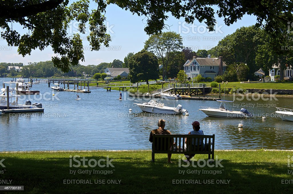 Summer Scene, couple on waterside bench, Connecticut, New England, USA stock photo