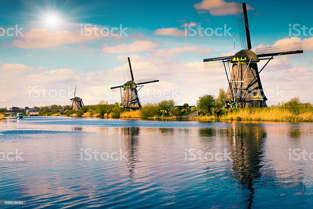 Summer scene in the famoust Kinderdijk canal with windmills stock photo