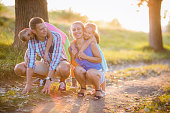 Summer scene of Happy young family