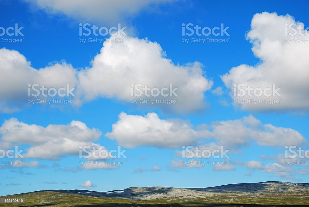 Summer sky over the green hills of Mageroya. stock photo