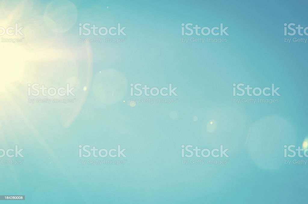 Summer sky with light flares stock photo