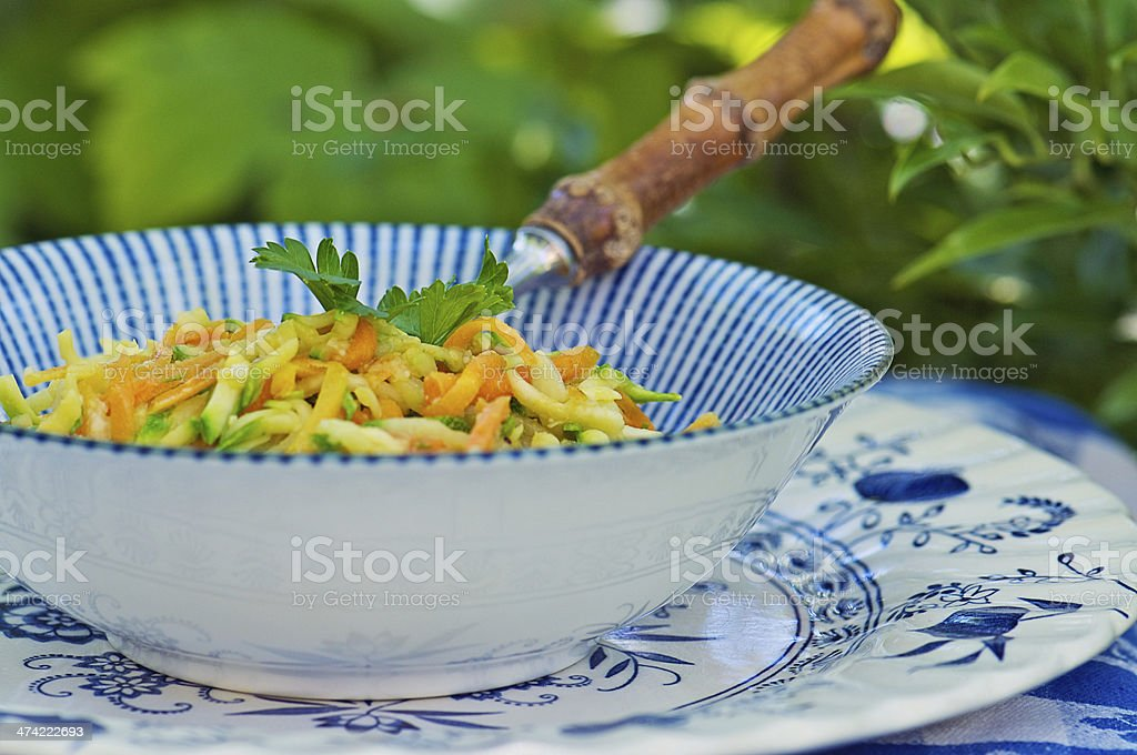 Summer Slaw Salad of Grated Squash and Carrots taken Outdoors stock photo