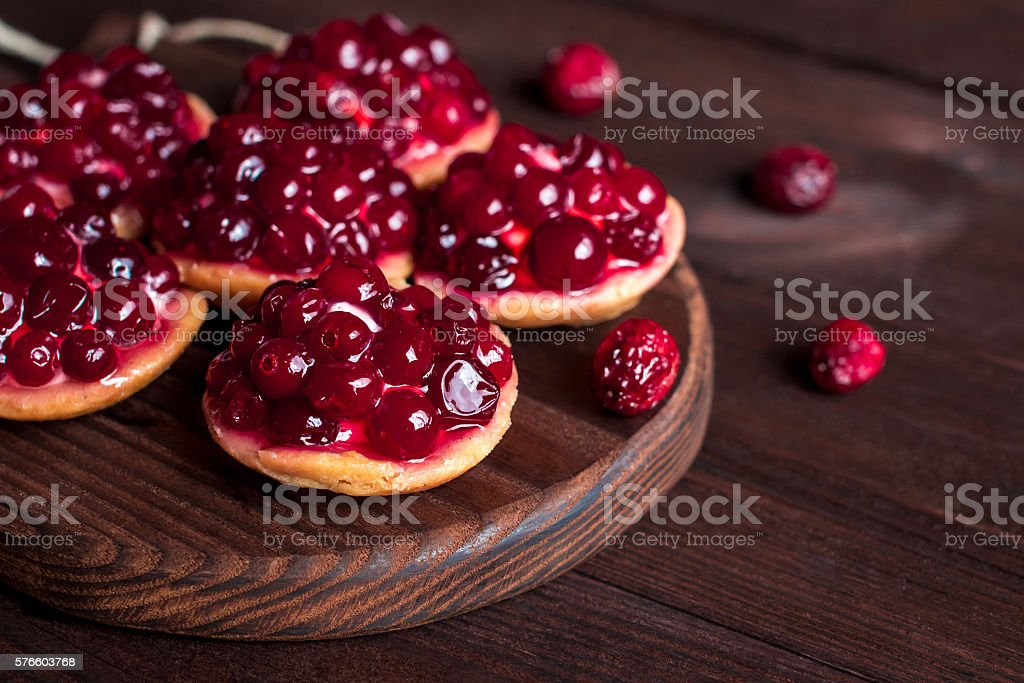 summer small cakes on wooden white background, close-up stock photo