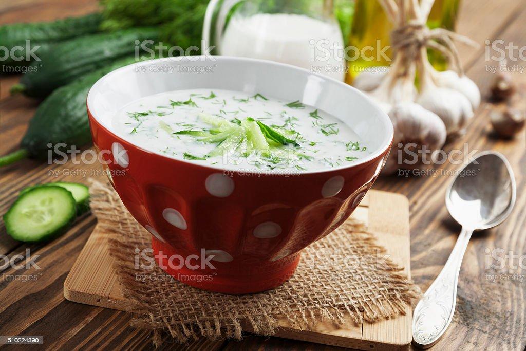 Summer soup with cucumbers, yogurt and fresh herbs stock photo
