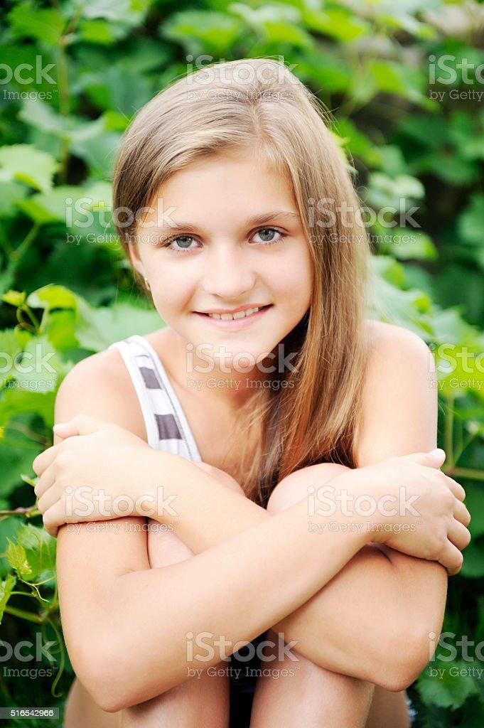 Summer, Spring, Preadolescent girl, blonde hair, smiling having fun sitting stock photo