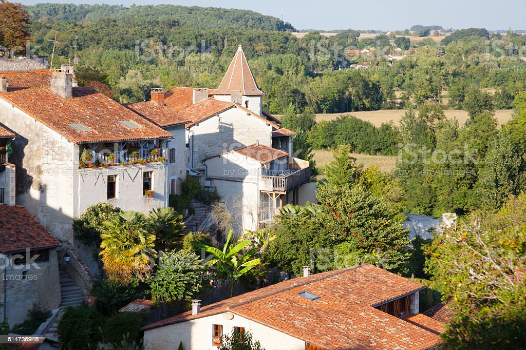 summer sunny french village of Aubeterre with houses and roofs stock photo