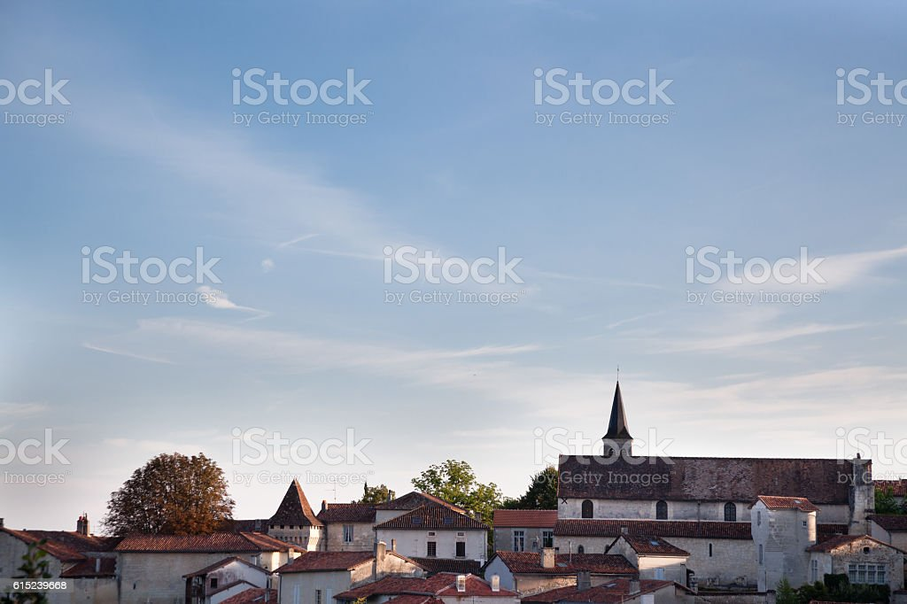 summer sunny french village of Aubeterre with houses church roofs stock photo
