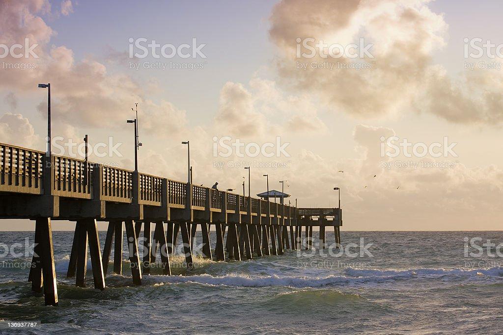 Summer sunrise scene with fishing pier in Miami Beach Florida royalty-free stock photo