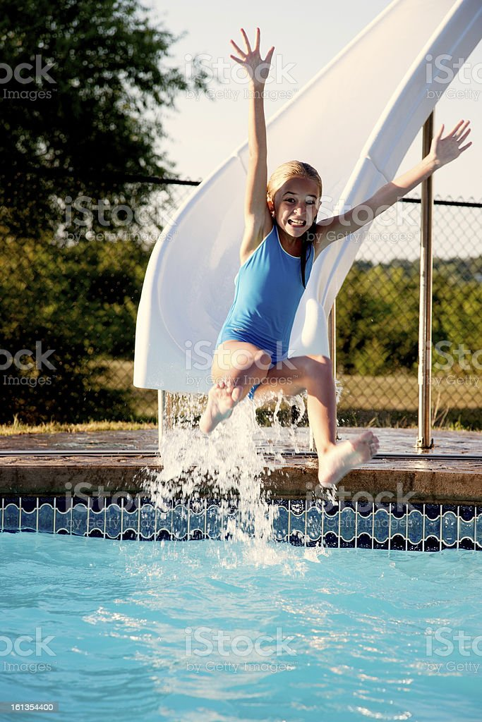 Summer Swimming: Caucasian Little Girl on Water Slide Outdoor Pool stock photo