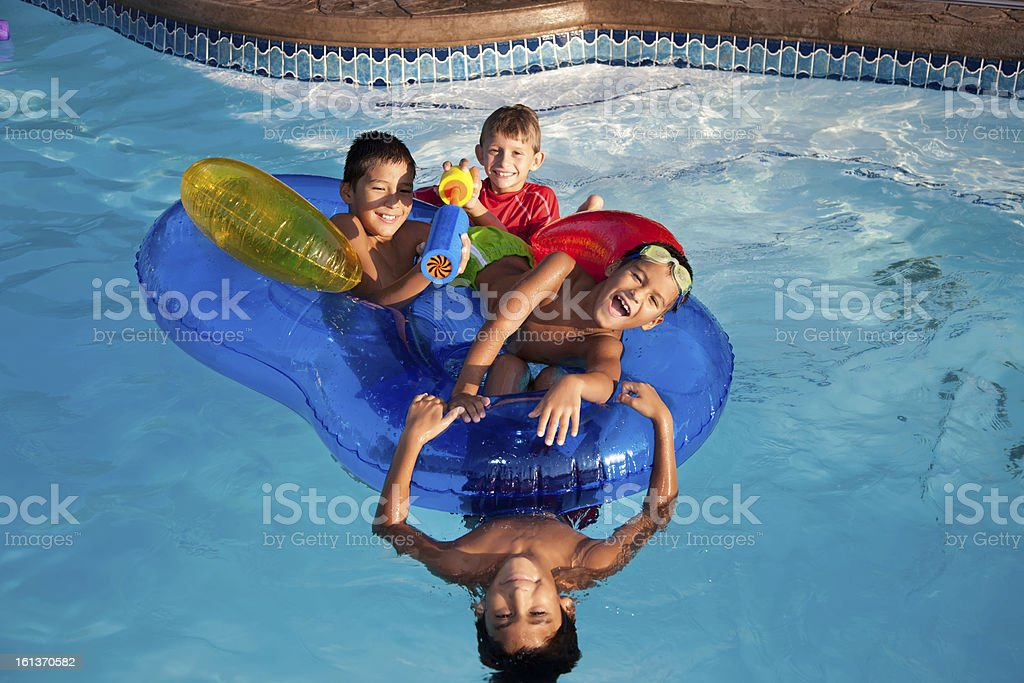 Summer Swimming: Group Little Boys Playing in Water Outdoor Pool royalty-free stock photo