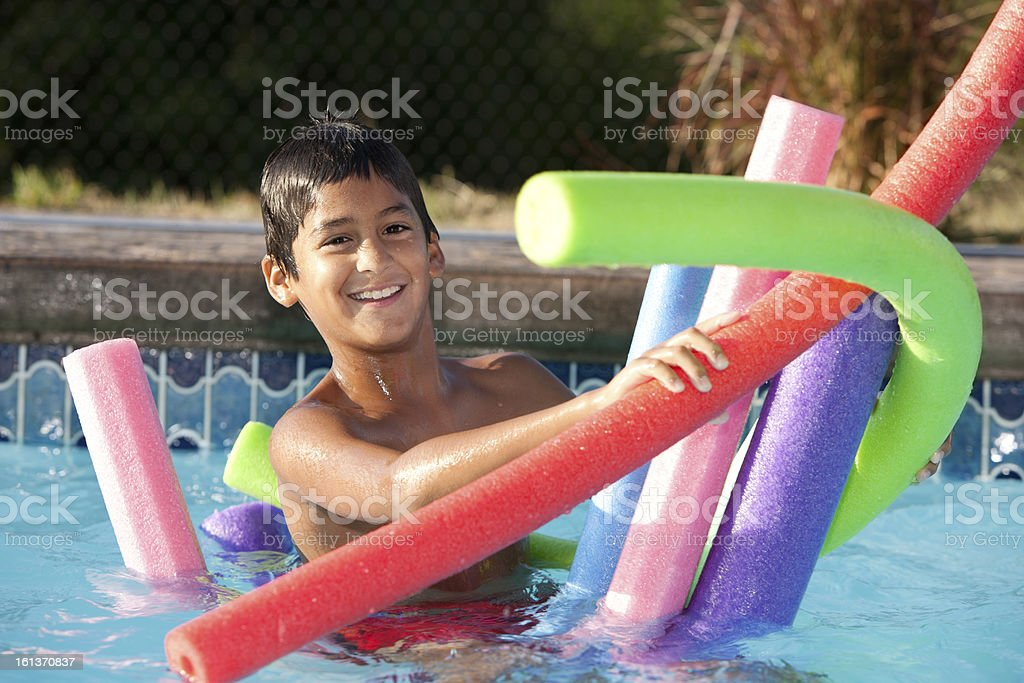 Summer Swimming: Hispanic Little Boy Playing in Water Outdoor Pool stock photo