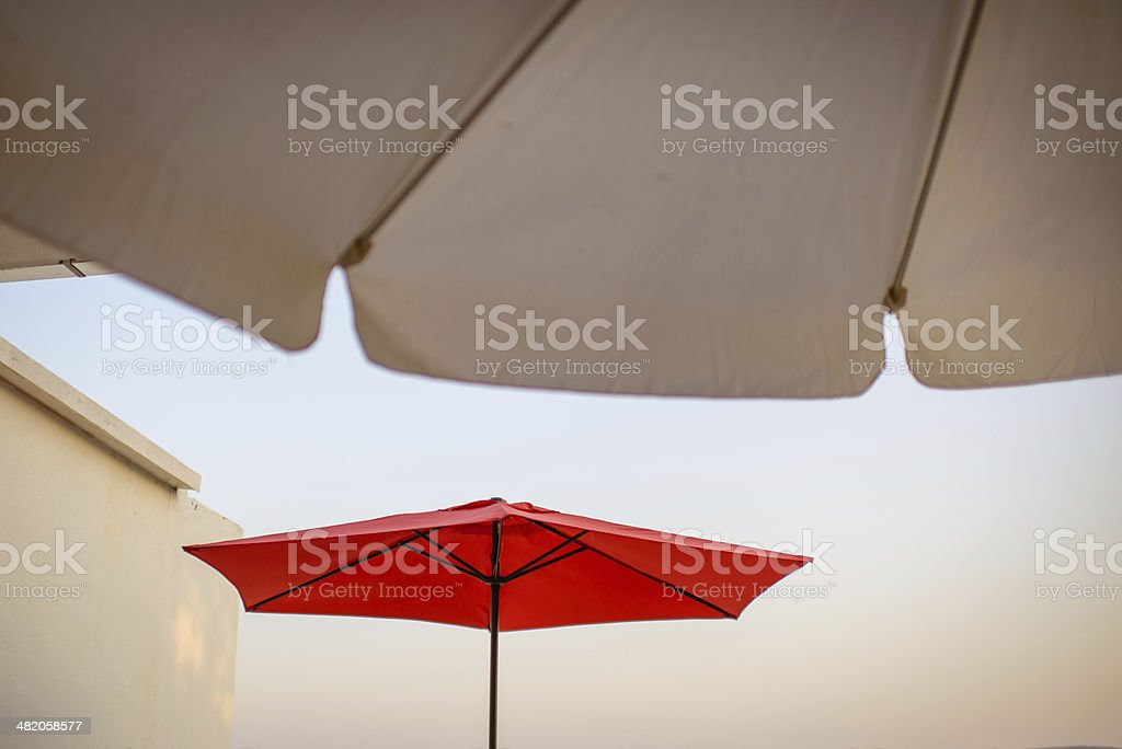 Summer terace with red umbrella. stock photo