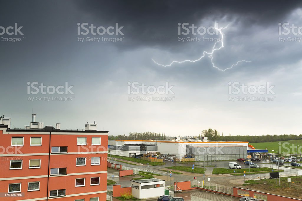Summer thunderstorm over the city buildings royalty-free stock photo