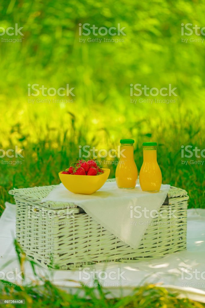 Summer time: picnic on the grass - juice and berries. stock photo