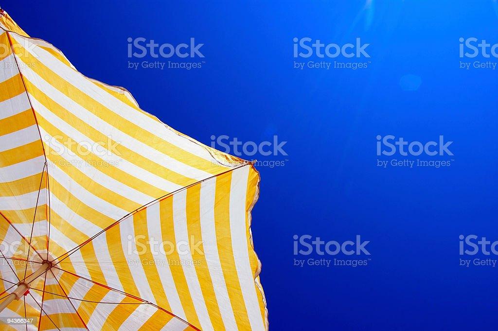 Summer Time, Sunbathing under an Umbrella royalty-free stock photo