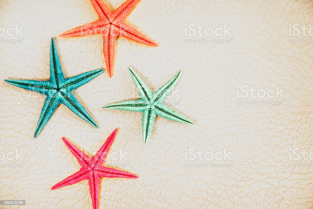 Summer vacation.  Colorful starfish on white background. stock photo