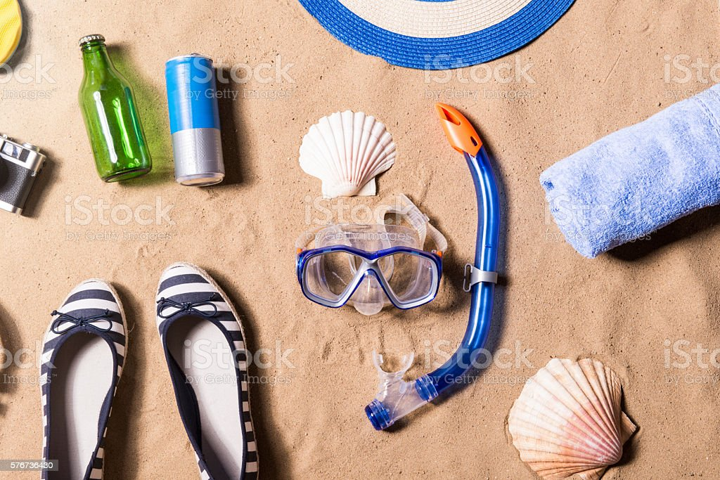 Summer vacation composition. Shoes, goggles and other stuff, bea stock photo