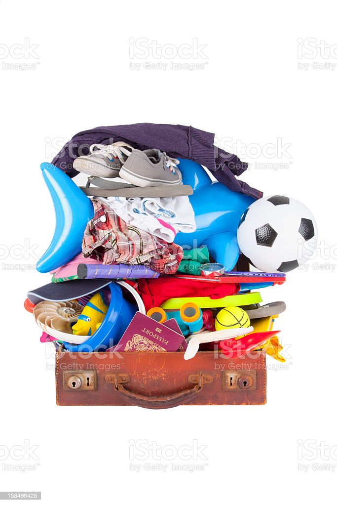 summer vacation or holiday suitcase really packed, cannot close stock photo