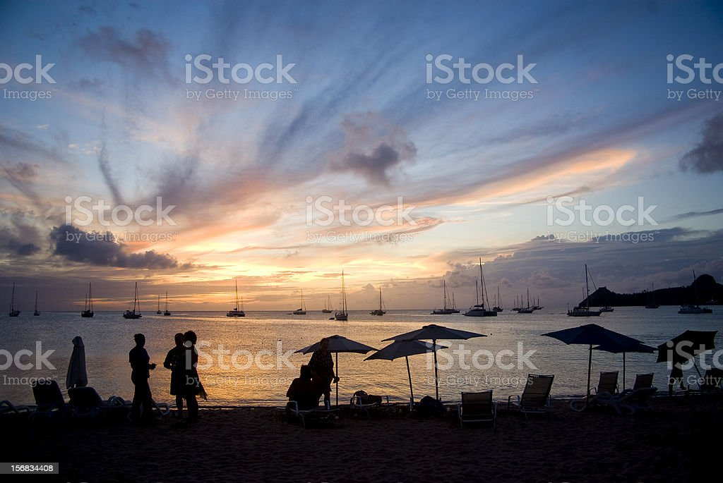 summer vacation; people on beach at dusk royalty-free stock photo